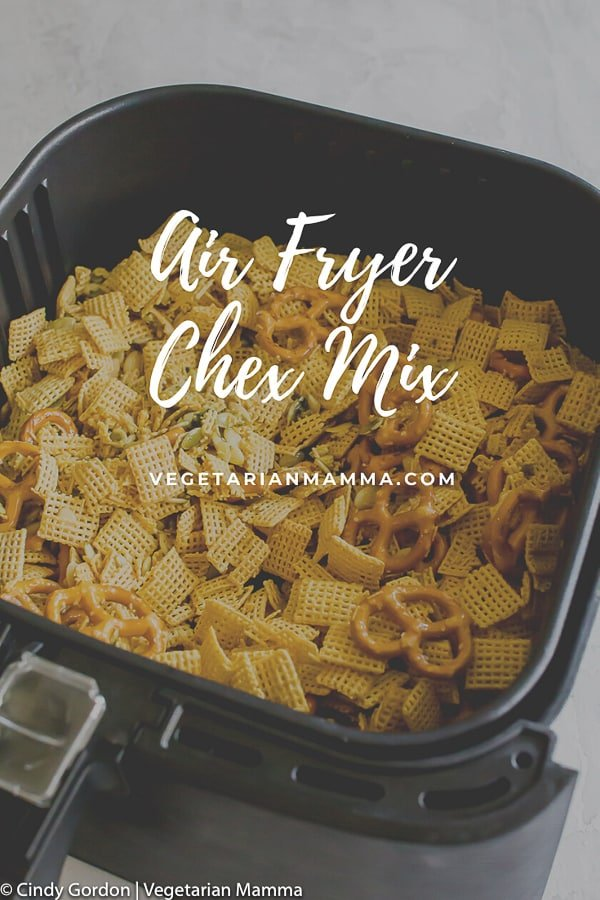 Air Fryer Chex Mix pictured in an air fryer basket