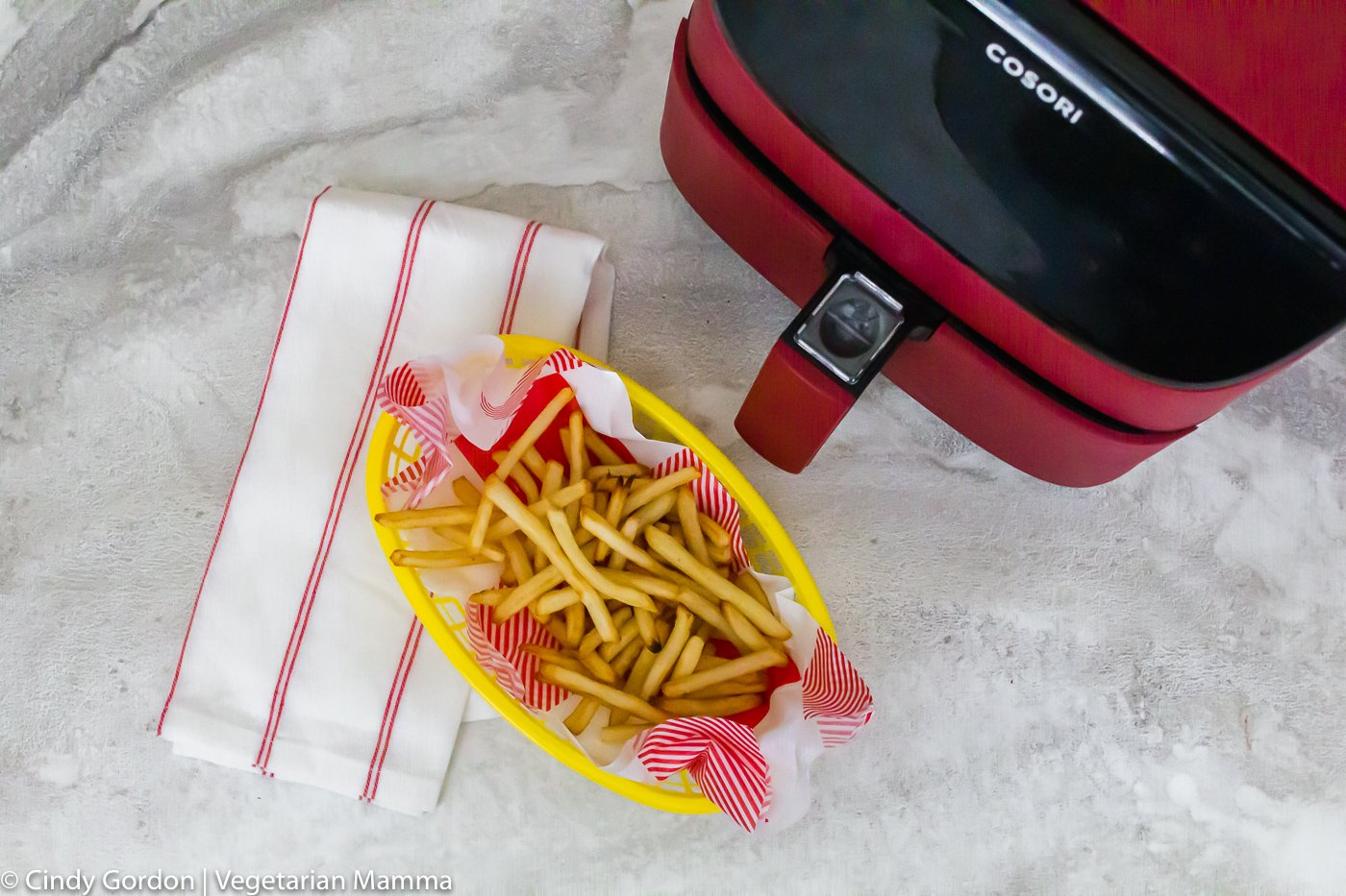 overview of cooked fries and air fryer unit