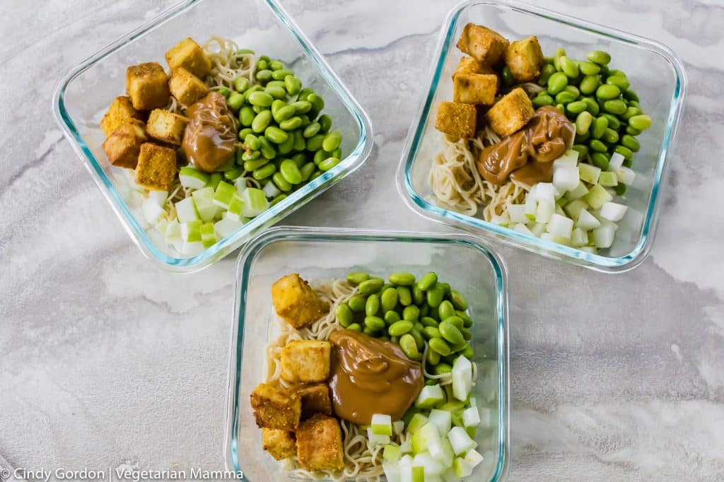 Tofu Noodle Bowl Recipe with tofu, noodles, edamame, and sauce, divided into three bowls