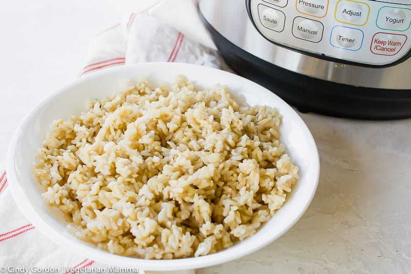 instant pot cooked brown rice in a round white bowl