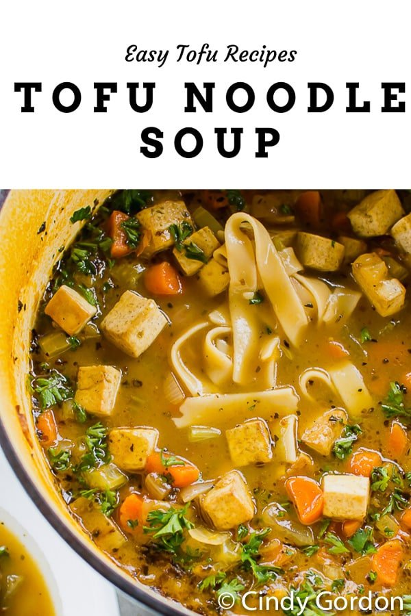 Hearty, flavorful, and packed with veggies, this simple Tofu Noodle Soup is the perfect pot of delicious comfort on any day! #veganchickennoodlesoup #tofusoup #noodlesoup