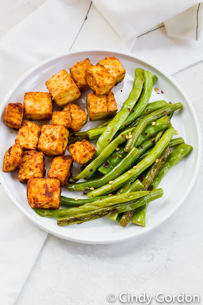 Baked tofu with paprika and garlic salt with a side of green beans