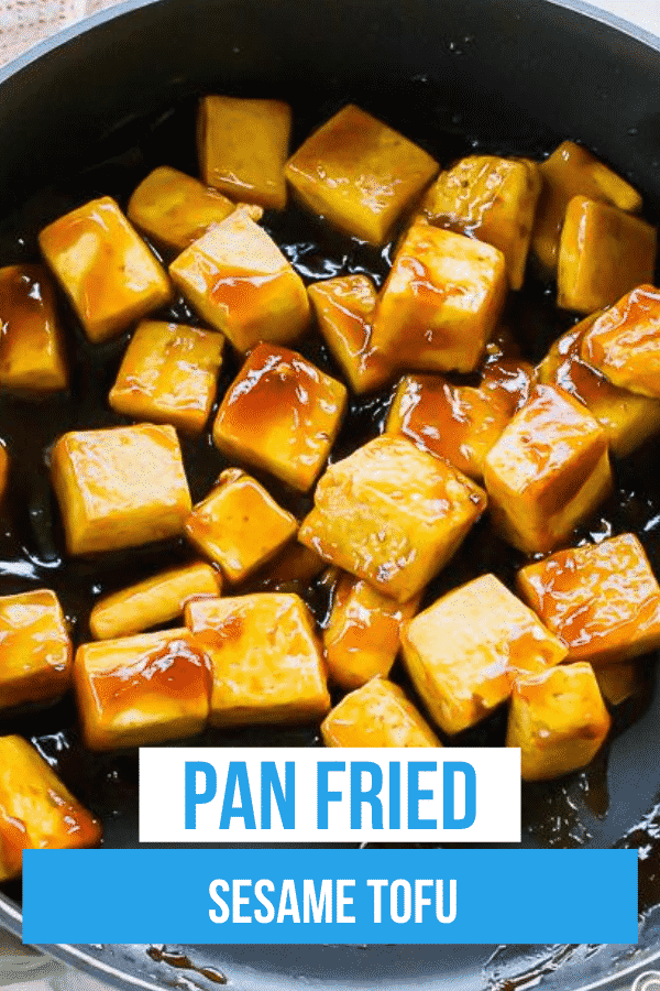Sesame Tofu is the easiest Asian-inspired vegetarian dish ever! Crispy pan-fried tofu is covered in a soy, honey, and sweet Thai chili sauce and garnished with sesame seeds. #sesametofu #tofu