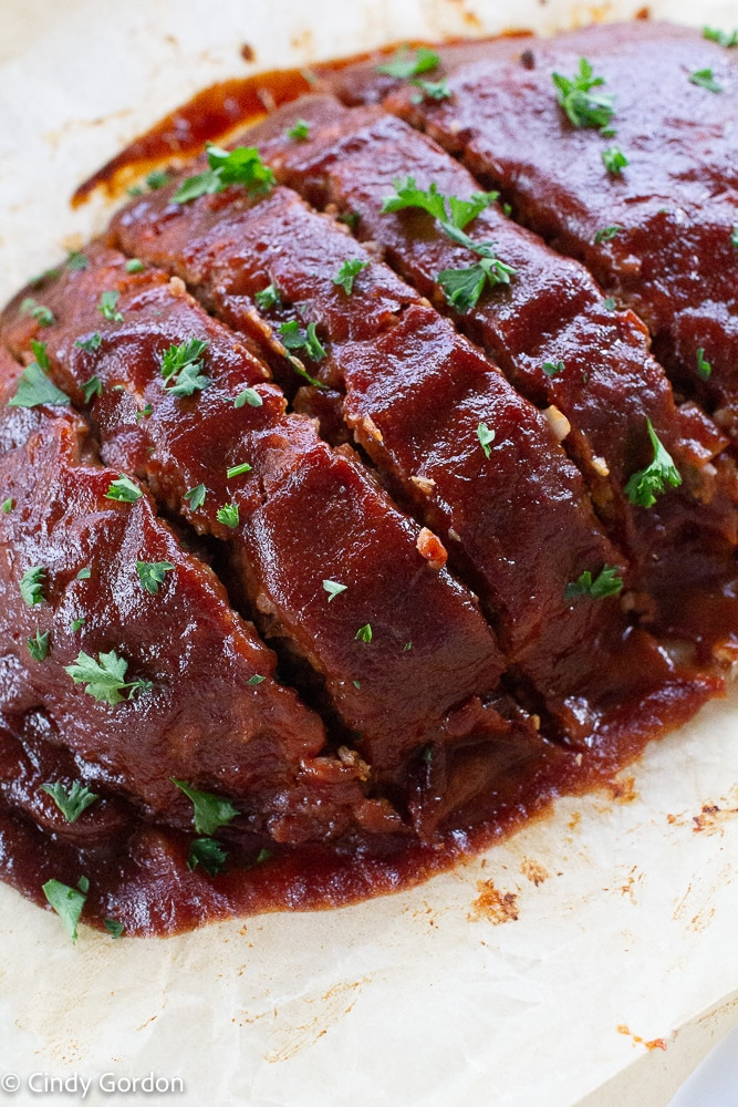 Close-up shot of a glazed Beyond Meat meatloaf garnished with parsley