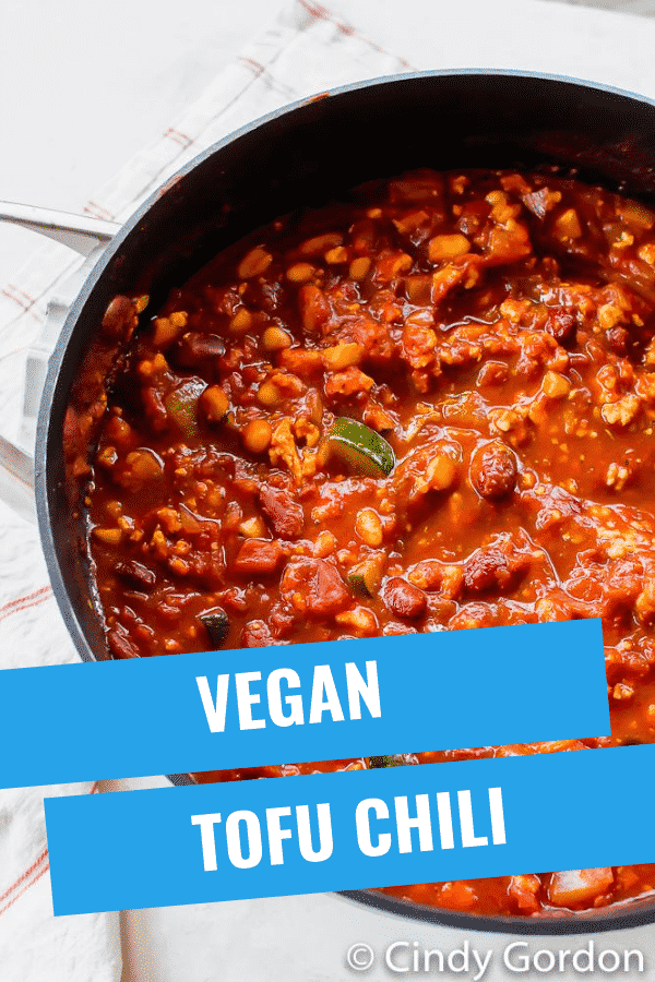 Hearty Tofu Chili is the best vegan comfort food. You can make this chili recipe in less than an hour with tons of succulent veggies and protein-packed beans. #vegansoup #veganrecipes