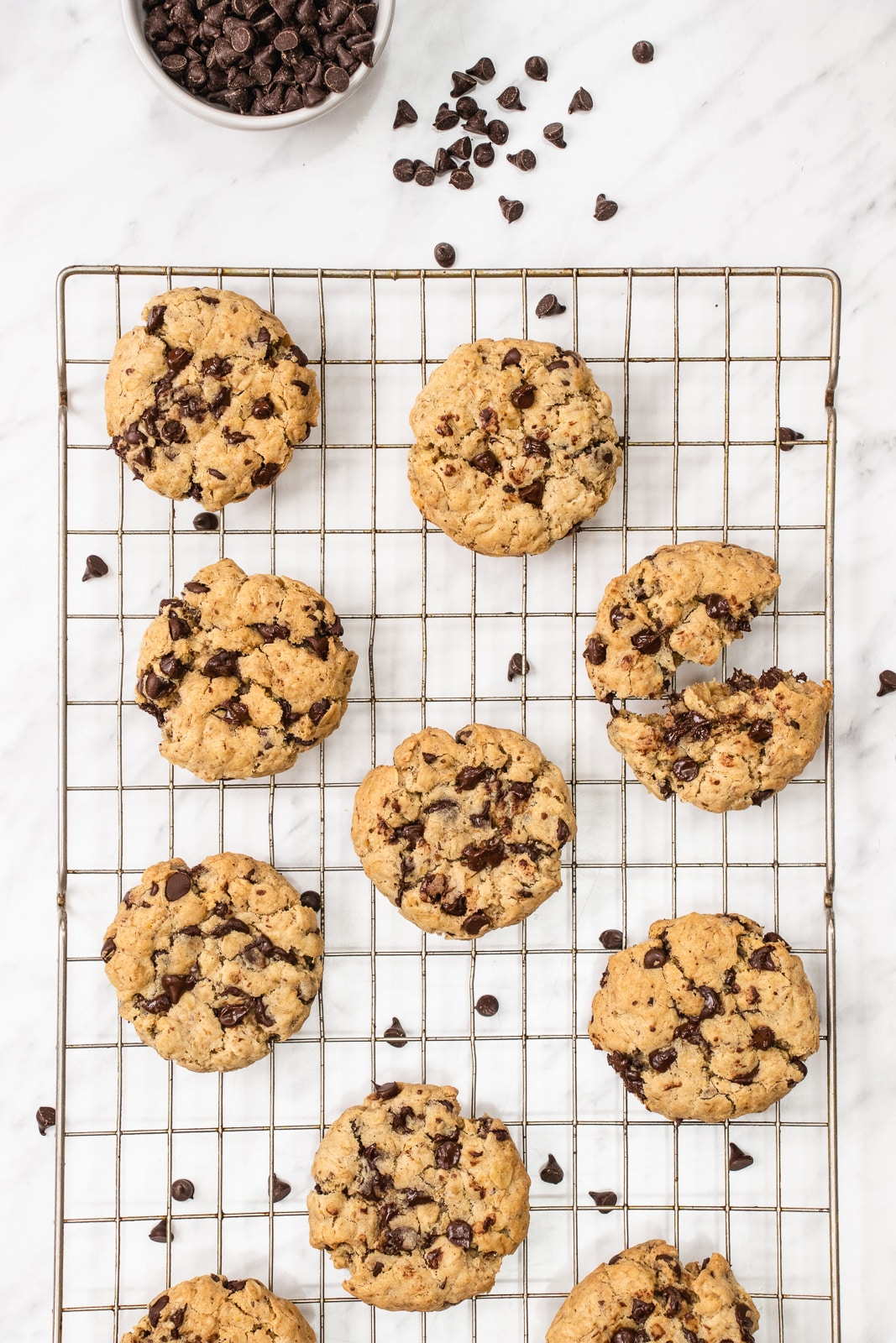 Chewy vegan oatmeal chocolate chip cookies cooling on a wire rack