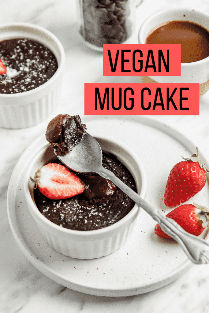 A bite of vegan chocolate mug cake over the ramekin of cake with overlay text