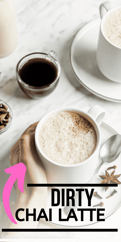 pinnable image of a hand holding a white mug with a foamy substance in it. The text overlay says dirty chai latte.