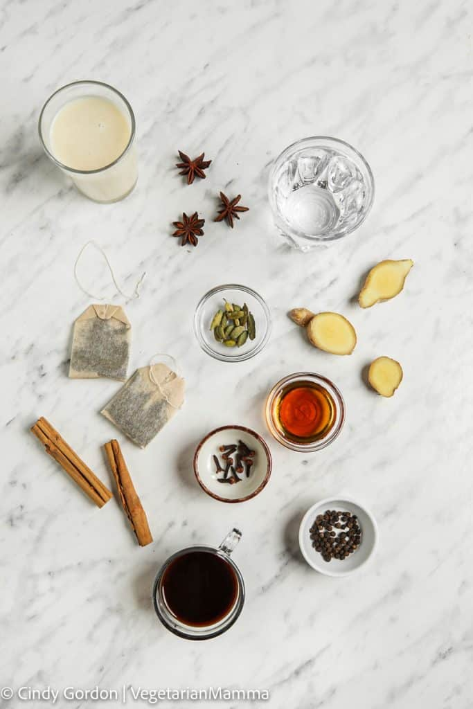 individual ingredients laid out for the dirty chai latte, all on a white marble board.