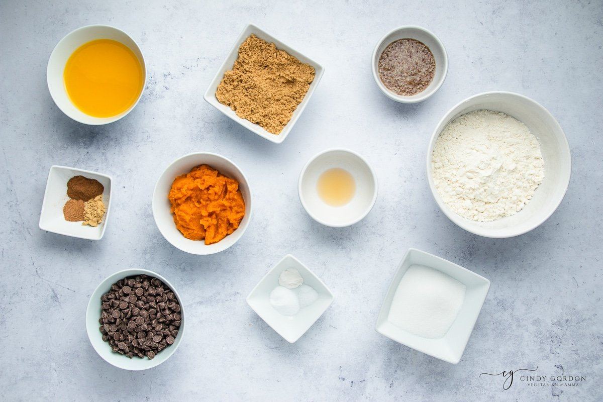 Bowls of flour, spices, pumpkin, vegan butter, brown sugar, caster sugar, and chocolate chips