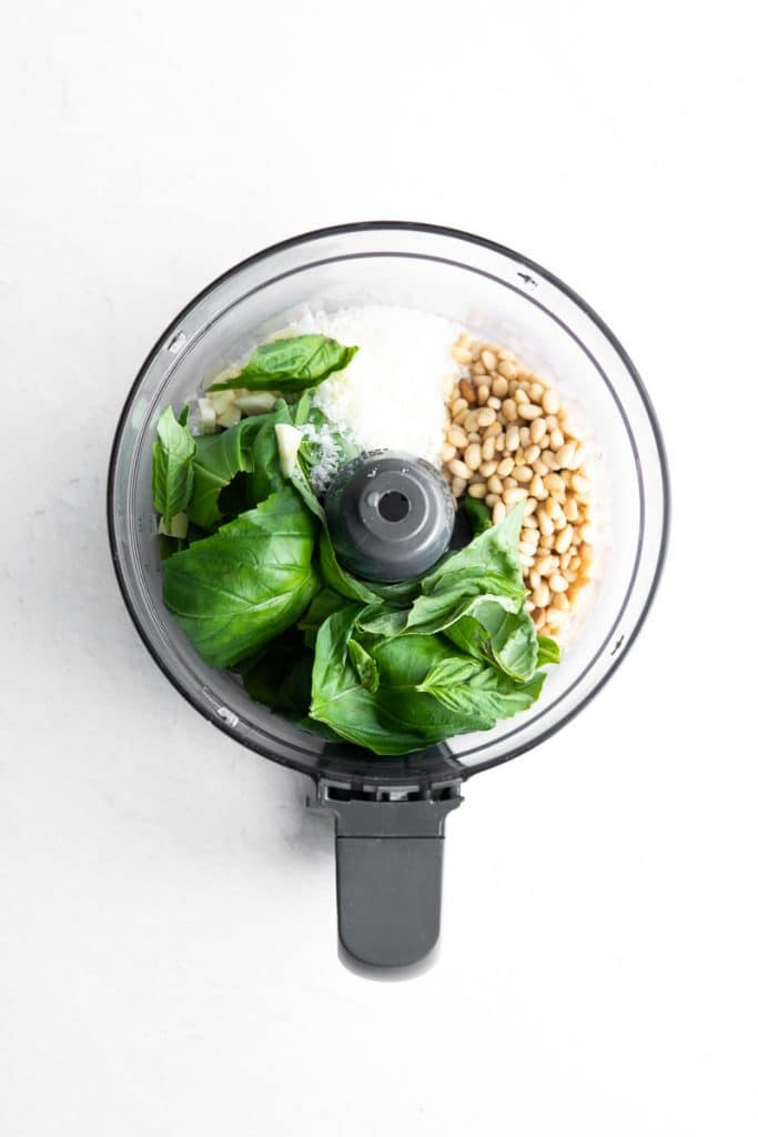 Ingredients for Basil Pesto in a food processor.