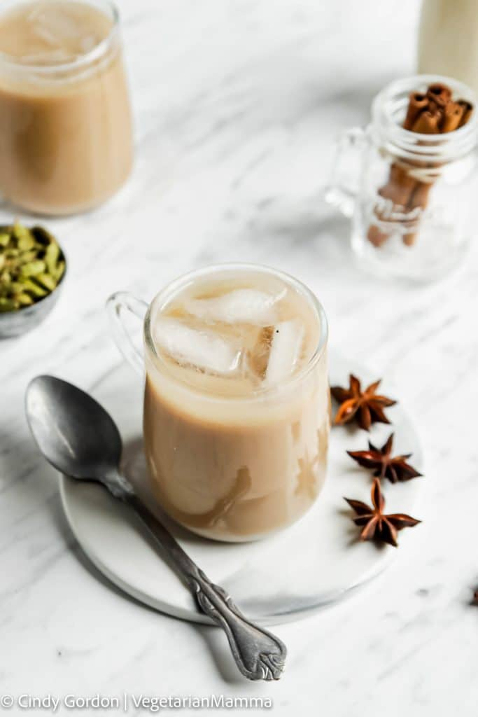 a glass mug filled with iced chai latte