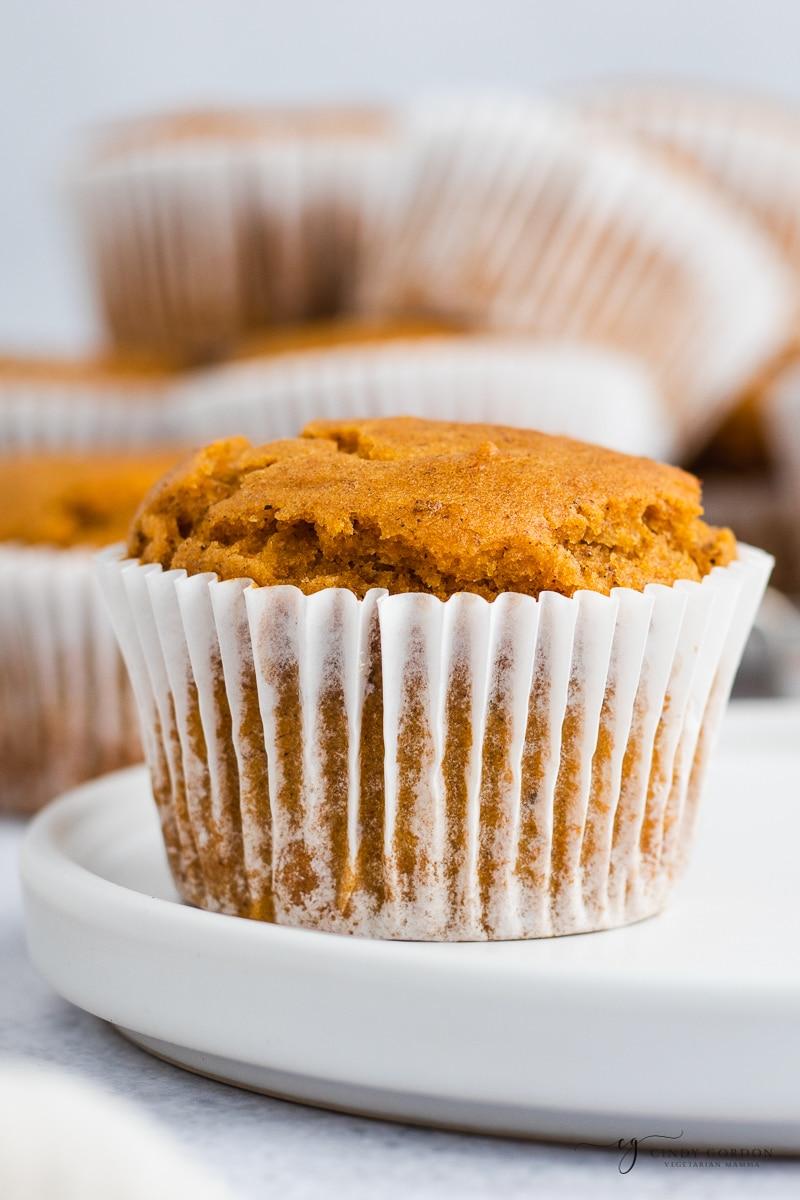 Close-up shot of a pumpkin muffin in a white cupcake wrapper
