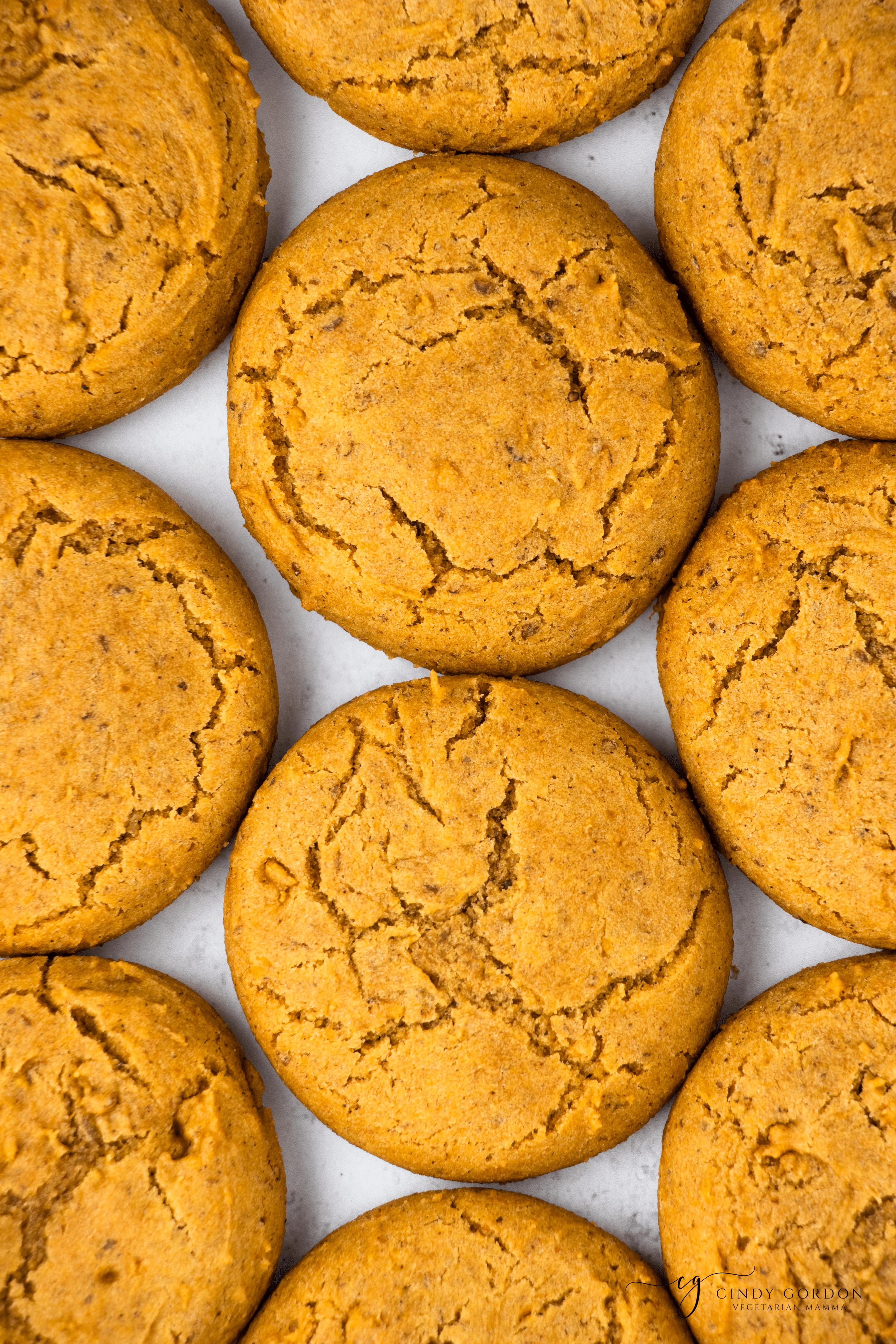 Overhead shot of a grid of fluffy vegan pumpkin cookies